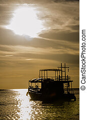 fishing boat in the sea in silhouette style