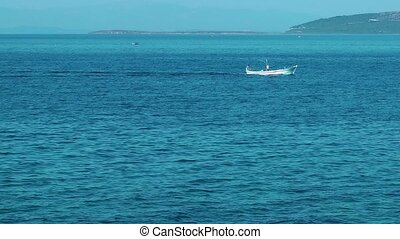 Fishing Boat in the Sea Water
