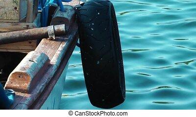 Fishing Boat in the Sea Water