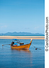 fishing boat in the sea with blue s
