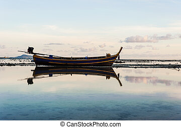 Fishing boat in the sea with morning light
