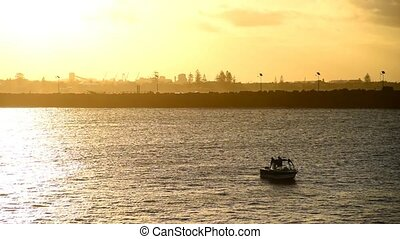Fishing boat in the sunset