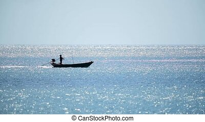 Fishing boat is out fishing in blue sea or ocean