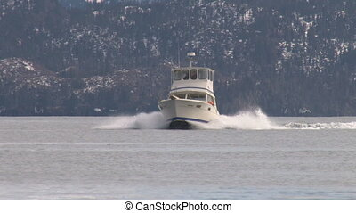 Sporty fishing boat out on the bay during a shakedown cruise, pilot training, or just having fun.