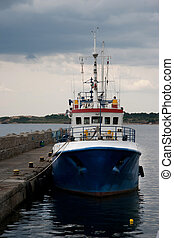fishing boat moored at a dock - Fishing trailer at the port....