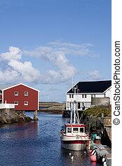 Fishing boat moored to the wharf in idyllic Veiholmen, Smola, western Norway
