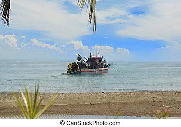 Fishing boat near the beach photo