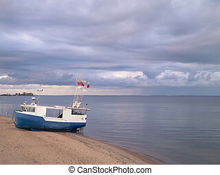 Fishing boat on Baltic Sea coast.