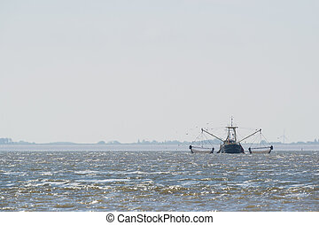 fishing boat with nets on Dutch wadden sea