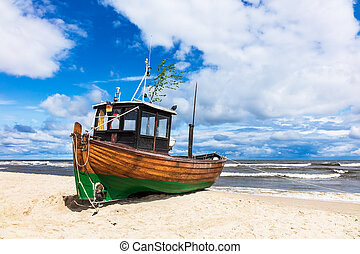 Fishing boat on shore of the Baltic Sea in Ahlbeck, Germany