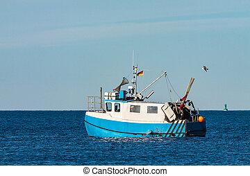 Fishing boat on the Baltic Sea in Warnemuende