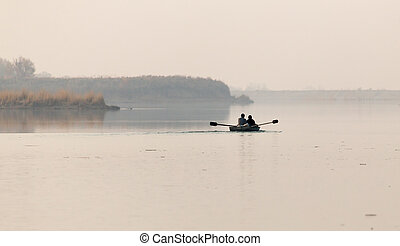 fishing boat on the lake at sunset