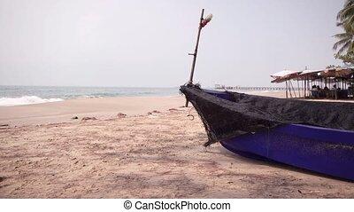 fishing boat on the sea splashing the waves.