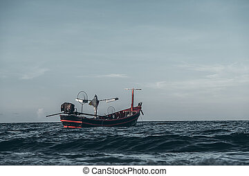 Fishing boat on the sea with space on the sky