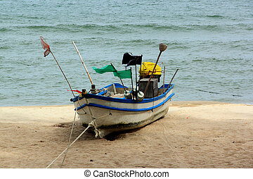 fishing boat on the white beach