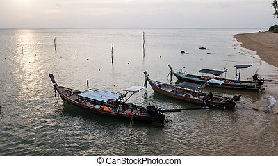 Fishing boat parked on the sea shore