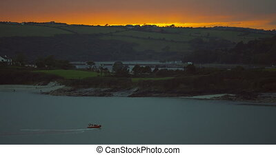Fishing boat sailing early in the