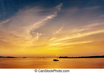 Fishing boat silhouette at sea