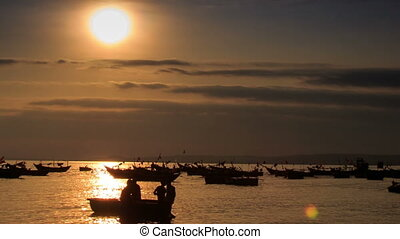 Fishing Boat Silhouette Rows in Sea Bay at Sunset in Vietnam