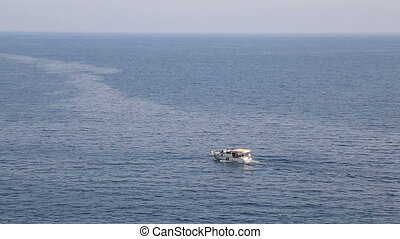 Fishing boat trawler on sea - Boat shot from above while...