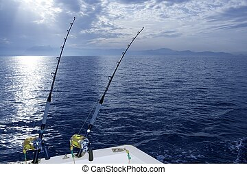 Fishing boat trolling with two rods and reels