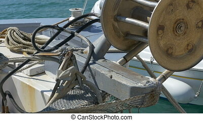 Fishing Boat Winch and Anchor - Old winch boat and anchor on...
