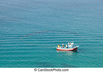 Fishing boat with a net in the sea