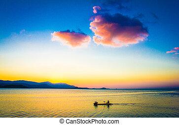 Fishing Boat with fisherman at Sunset on Koh Samui