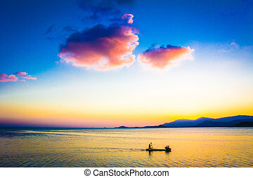 Fishing Boat with fisherman at Sunset on Koh Samui