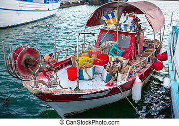 Fishing boat with fishing gear in Limassol Old Port.