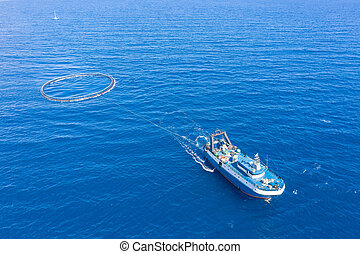 Fishing boat with special equipment for fishing, fish frame sails in the Mediterranean sea.