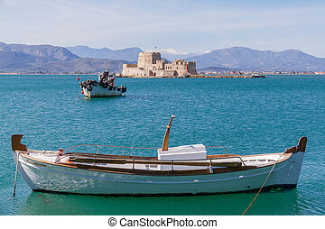 Traditional Fishing Boats and Bourtzi Fortress in the background in Nafplion, Greece- landscape photo