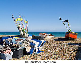 Fishing boats and gear on beach.