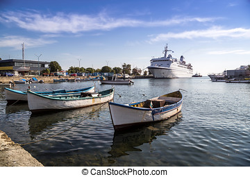 Fishing boats and passenger ship - Passenger ship and...