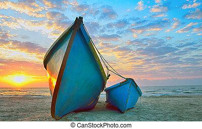 Fishing boats and sunrise on Black Sea beach