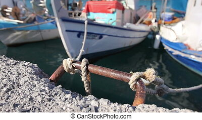 Fishing boats are tied with rope for the pier, wharf...