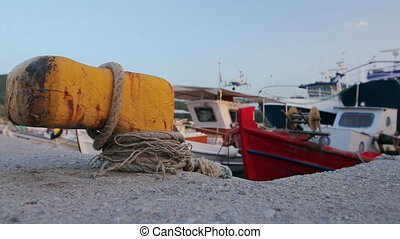 Fishing boats are tied with rope for the pier, wharf close-up at marina