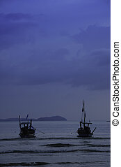 Fishing boats at the beach in the evening