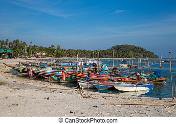 Fishing boats at the beach on Koh Samui in Thailand.