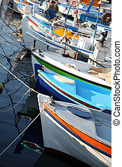 Fishing boats docked in harbor, Elounda, Crete, Greece. ...