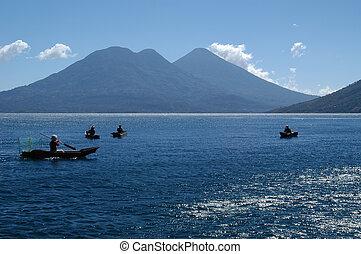 Men fishing in the traditional manner in Lake Atitlan, the largest lake of Guatemala