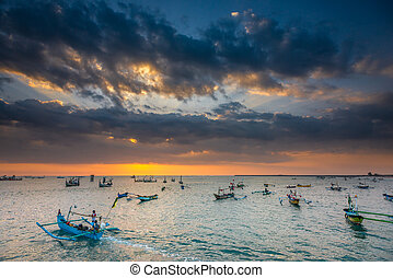 Fishing Boats heading out at sunset