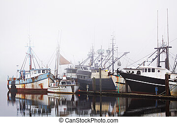 fishing boats in harbor fog with copyspace