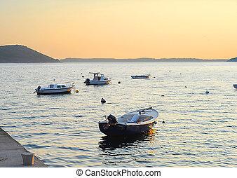 Fishing boats in Herceg Novi harbor at sunset. Montenegro