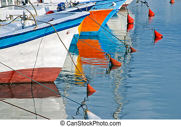 Fishing boats in Old Jaffa, Israel. - Boats moored on a...