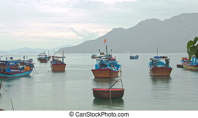 Fishing Boats in Sea Bay against Hill in Vietnam