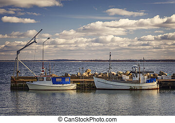 Fishing boats in small harbour