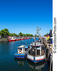 Fishing boats in spring time in Warnemuende, Germany.