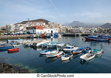 Fishing boats in the harbor of Los Cristianos. Canary Island Tenerife, Spain