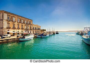 fishing boats in the harbor of Ortigia island